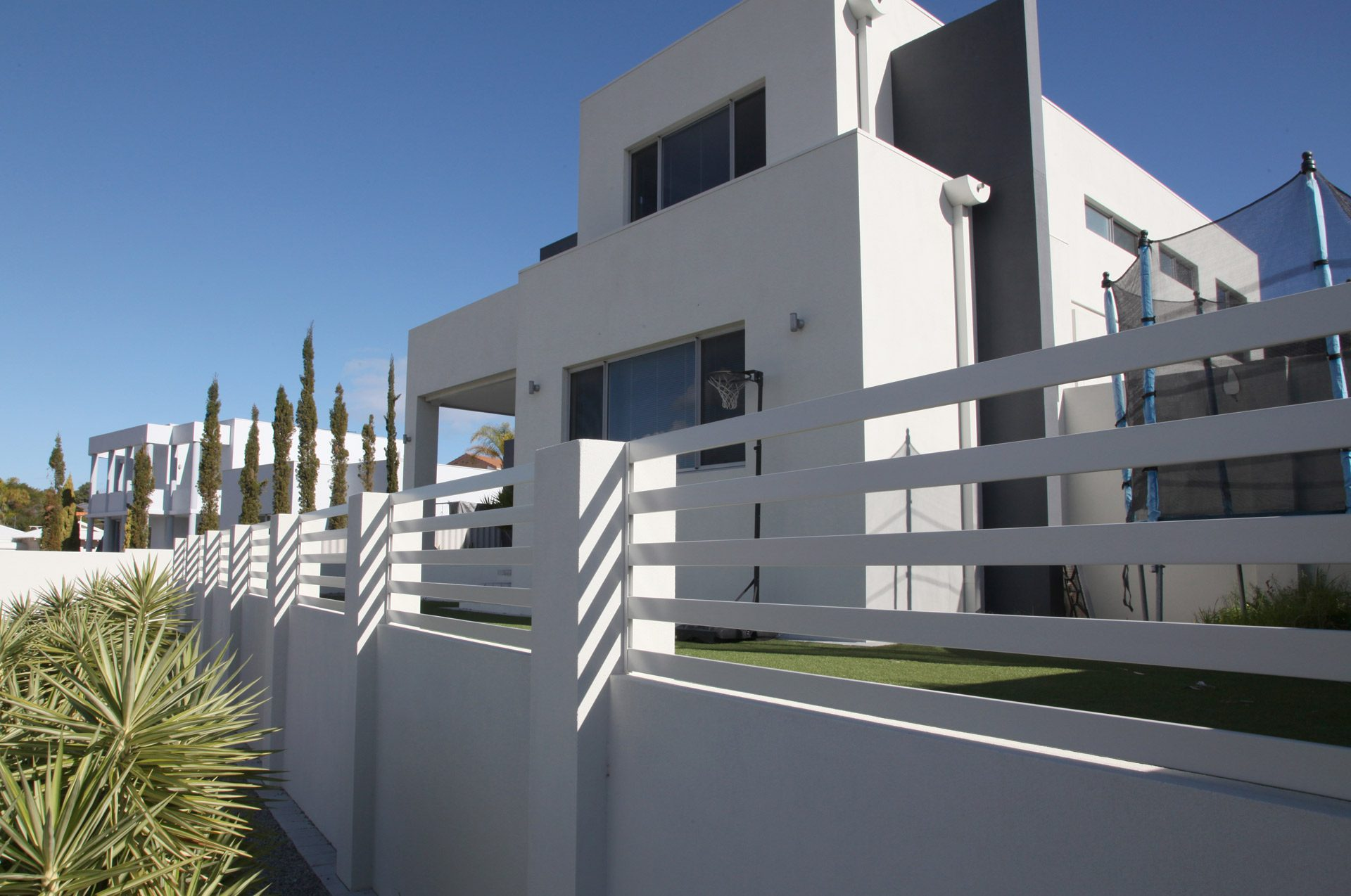 Aluminium Slat Fences are well suited to Modern Houses