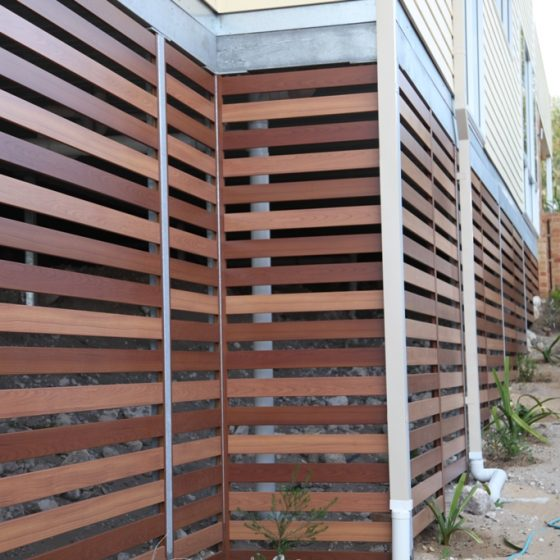 Screening using 100mm mixed Timber Effect Slats in Light Oak and Bush Cherry